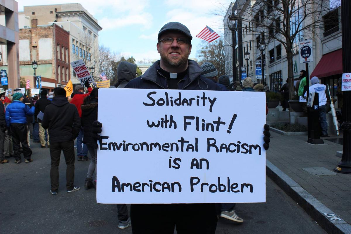 Person holding Flint sign