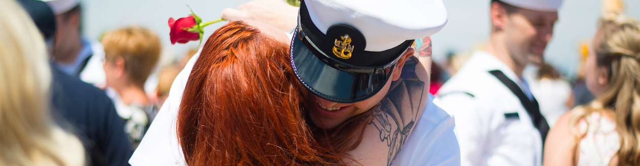 A military couple hugging