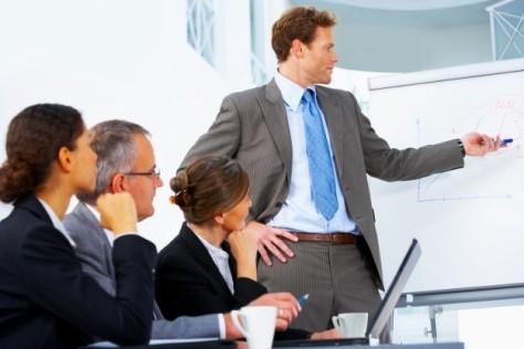 Businessman pointing to board