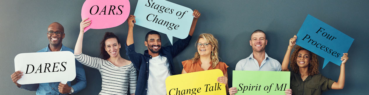 People standing with stages of change signs