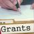 Student writing a grant